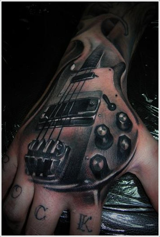 25 creative guitar tattoo designs for Electric hand tattoo