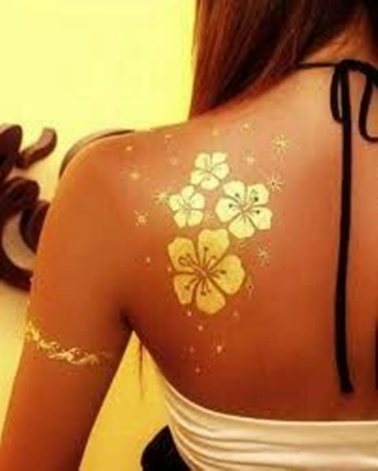 10 flashy gold tattoos ideas for Metallic tattoo ink