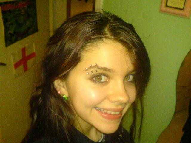 3rd_Eyebrow_piercing_by_queenofpaper