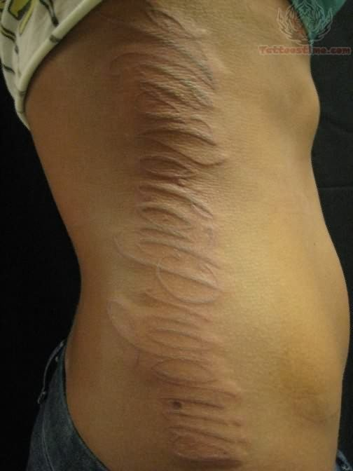 side-rib-white-ink-tattoo