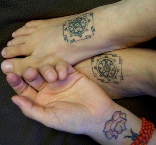 buddhist-wheel-tattoo-on-feet