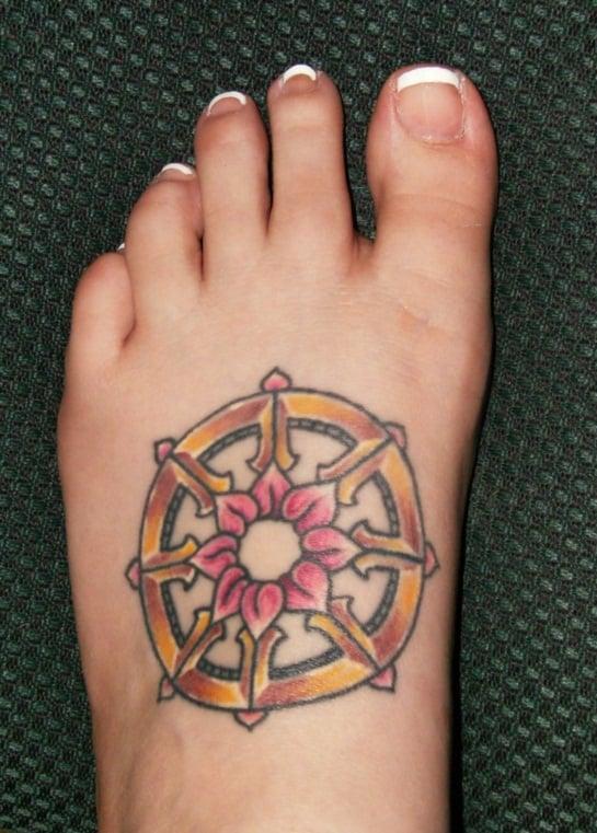 wheel-buddhist-tattoos-on-foot-733x1024