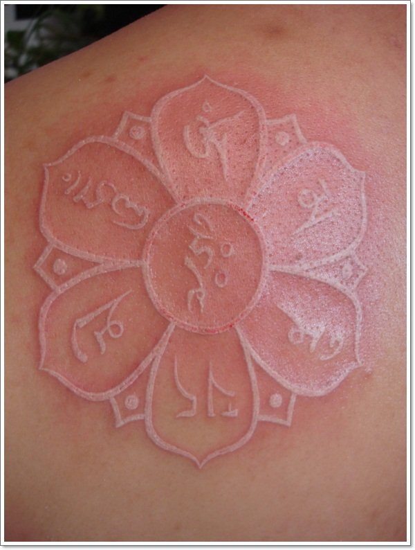 white ink lotus flower tattoo design