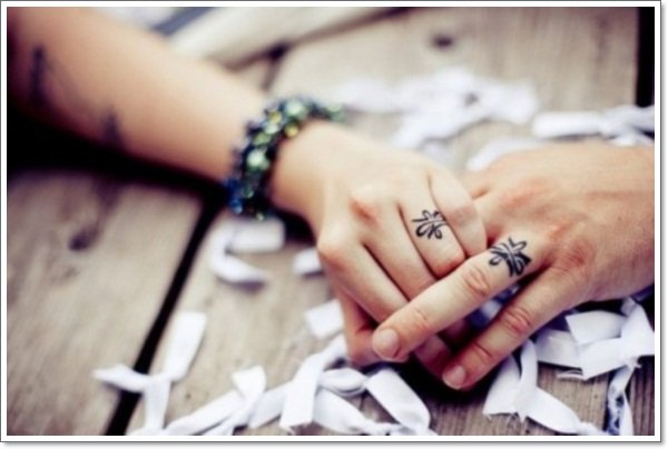awesome wedding ring tattoos 26 500x332