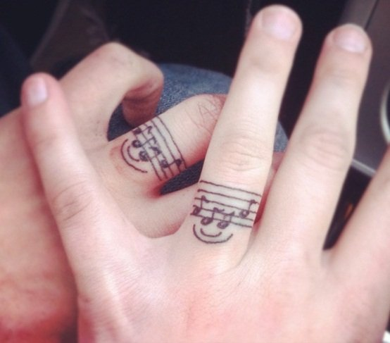 awesome wedding ring tattoos-37