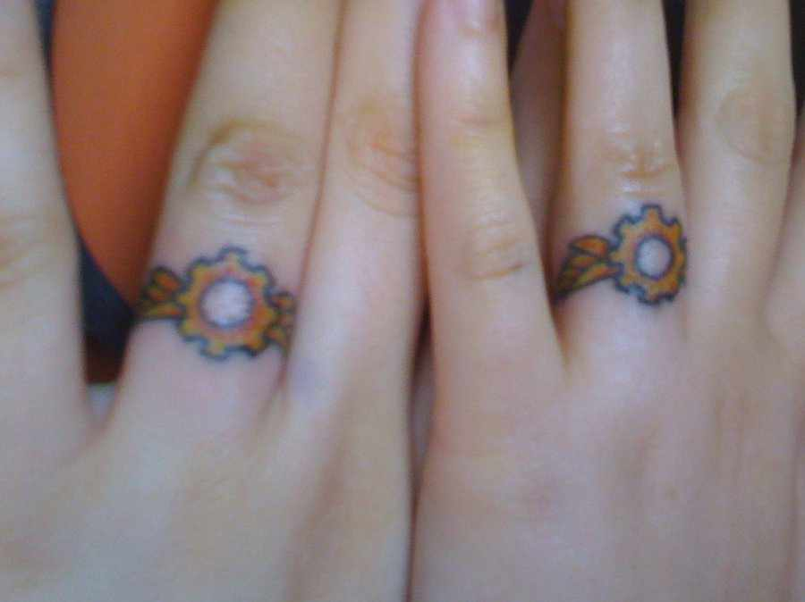 beautiful wedding ring tattoo design entertainmentmesh 63491 - Wedding Ring Finger Tattoos